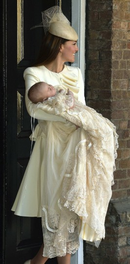 Britain's Catherine, Duchess of Cambridge carries her son Prince George after his christening at St James's Palace in London. (Pool/Getty Images)