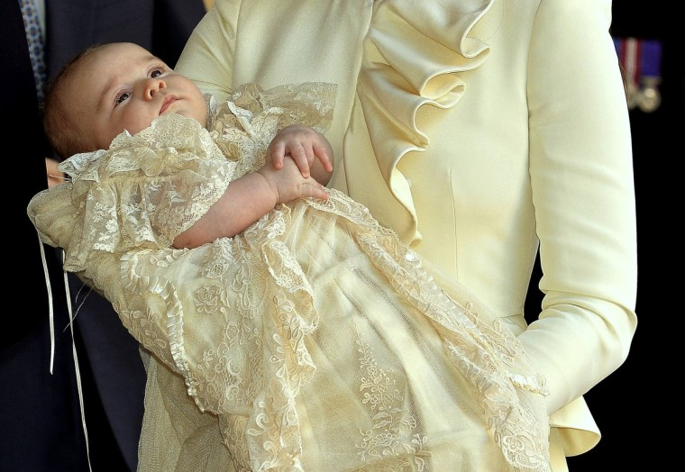 Britain's Catherine, Duchess of Cambridge carries her son Prince George after his christening at St James's Palace in London. (Pool/Reuters)