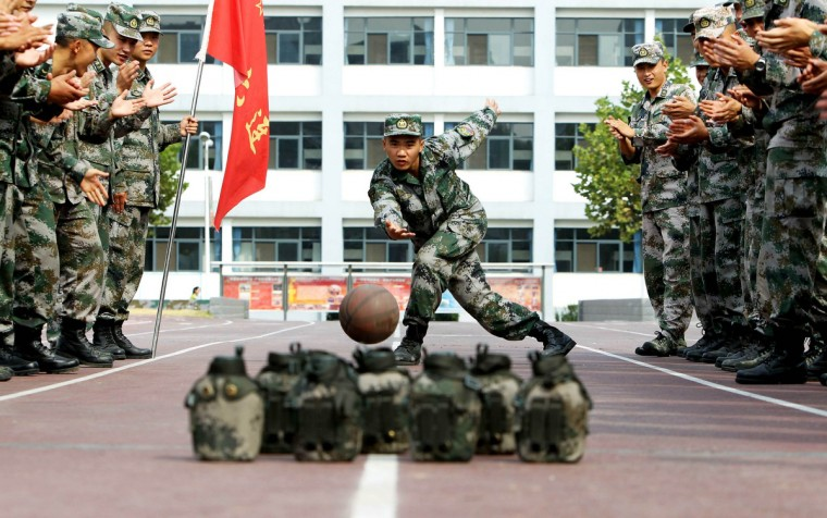 "Soldiers of Chinese People's Liberation Army ""bowl"" during China's seven-day National Day holiday in Jinan, Shandong province. (China Daily/via Reuters)"