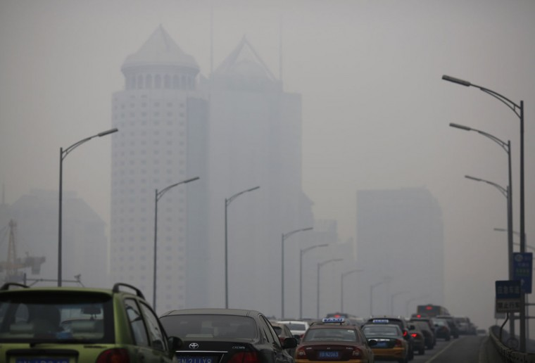 An overpass is crowded with cars amid the heavy haze in Beijing on February 23, 2014. (REUTERS/Kim Kyung-Hoon)