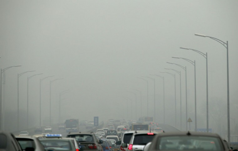Cars travel on an overpass amid thick haze in the morning in Beijing on February 26, 2014. (REUTERS/Kim Kyung-Hoon)