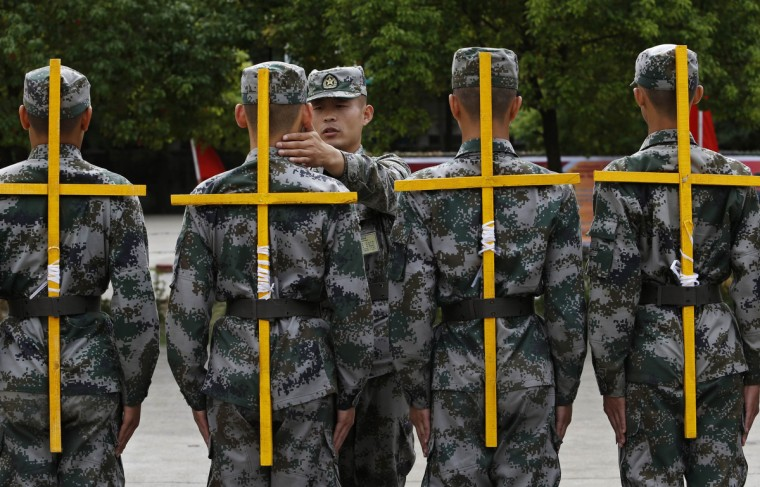 New recruits of the Chinese People's Liberation Army (PLA) take part in training to adjust their standing postures in Hangzhou, Zhejiang province. (William Hong/Reuters photo)