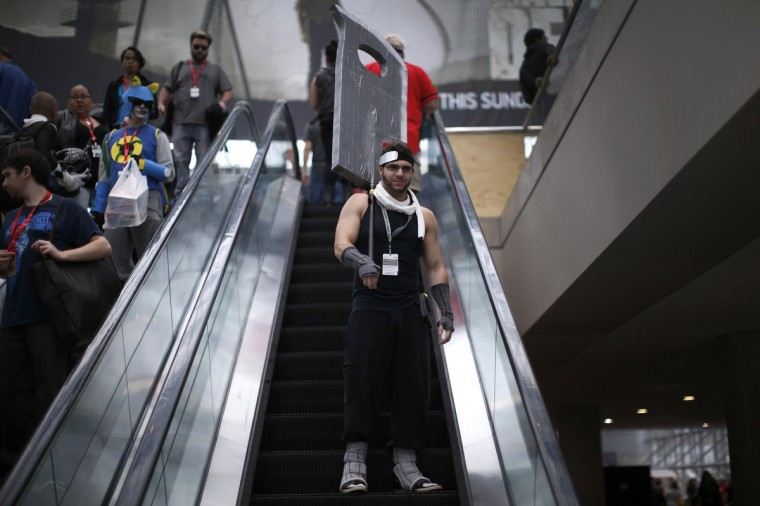 A man in costume rides an escalator at New York's Comic-Con convention. The event draws thousands of costumed fans, panels of pop culture luminaries and features a sprawling floor of vendors in a space equivalent to more than three football fields at the Jacob Javitz Convention Center on Manhattan's West side and has grown into one of the largest cons drawing an expected 120,000 fans. (Mike Segar/Reuters)