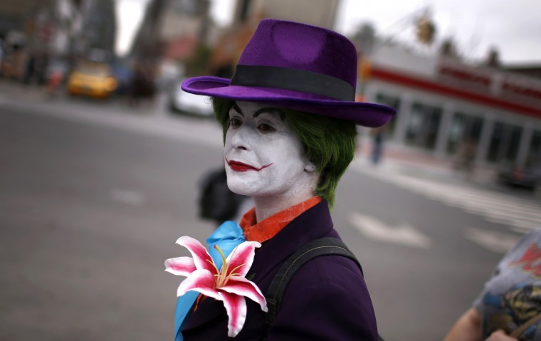 A fan dressed as the Joker from the Batman comic and movie series arrives at New York's Comic-Con convention. (Mike Segar/Reuters)