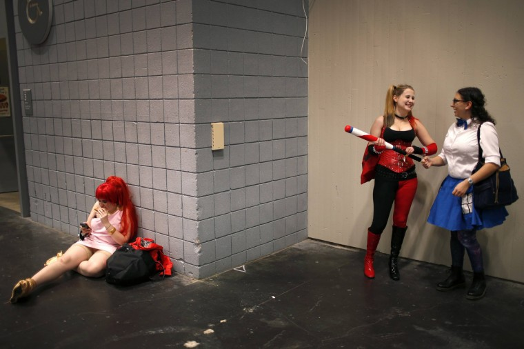 Costumed fans relax in a hallway at New York's Comic-Con convention. (Mike Segar/Reuters)