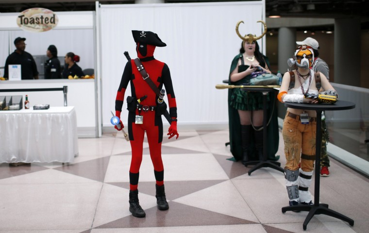 Costumed fans take a break from the convention floor at New York's Comic-Con convention. (Mike Segar/Reuters)