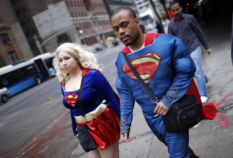 Fans dressed as Superman and Superwoman walk to New York's Comic-Con convention. (Mike Segar/Reuters)
