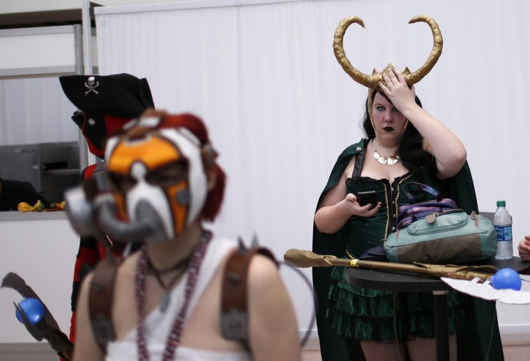 Fans in costumes take a break at New York's Comic-Con convention. (Mike Segar/Reuters)