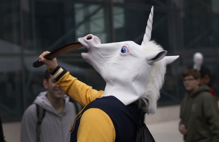 A fan dressed in a unicorn mask arrives at New York's Comic-Con convention. (Mike Segar/Reuters)