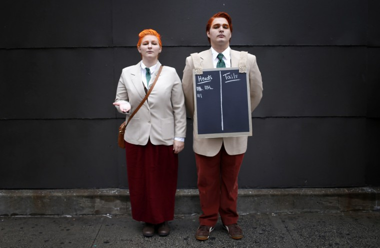 "Ben and Lee Mischaire dressed as the Lutece Twins from the video game ""Bio Shock"" poses for a photograph at New York's Comic-Con convention. (Mike Segar/Reuters)"