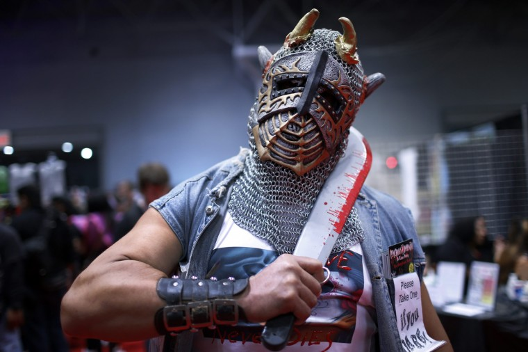 """A man dressed as a character from the comic """"Psychosis Y Dementia"""" poses for a photograph at New York's Comic-Con convention. (Mike Segar/Reuters)"""