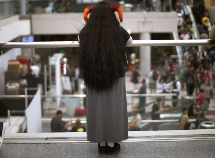 A fan in costume looks out at the crowd from a balcony at New York's Comic-Con convention. (Mike Segar/Reuters)