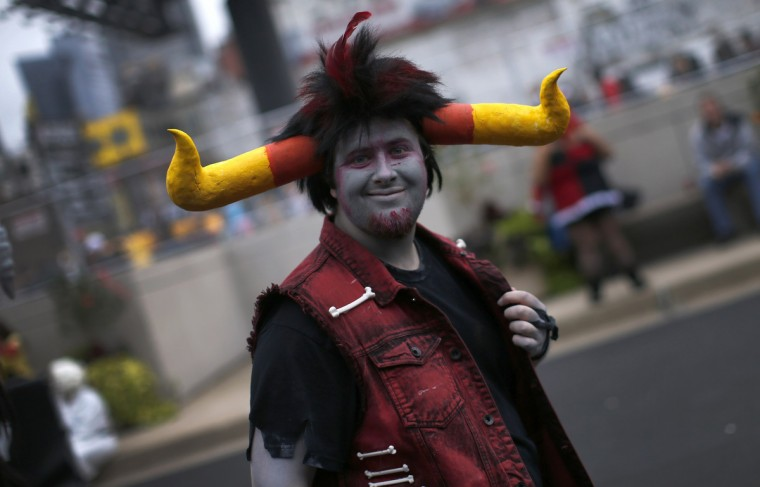 A fan in costume arrives at New York's Comic-Con convention. (Mike Segar/Reuters)