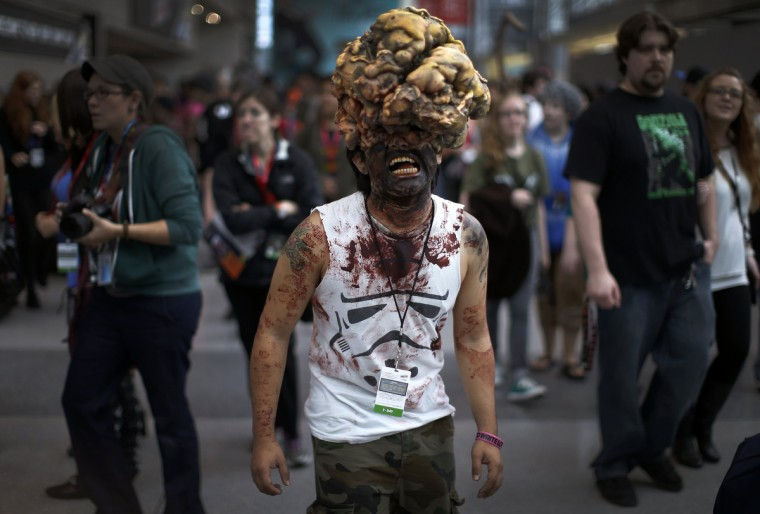 "Chris Perez dressed as a Clicker from the video game ""The Last of Us"" poses for a photograph at New York's Comic-Con convention. (Mike Segar/Reuters)"