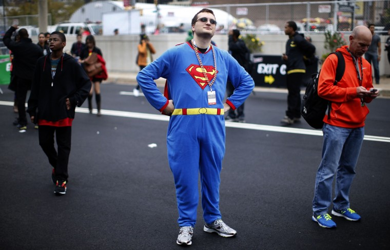 A man in a Superman costume poses for a photograph at New York's Comic-Con convention. (Mike Segar/Reuters)