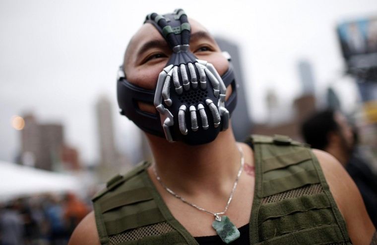 A man dressed as the comic book character Bane poses for a photograph at New York's Comic-Con convention October 11, 2013. The event draws thousands of costumed fans, panels of pop culture luminaries and features a sprawling floor of vendors in a space equivalent to more than three football fields at the Jacob Javitz Convention Center on Manhattan's West side and has grown into one of the largest cons drawing an expected 120,000 fans. (Mike Segar/Reuters)