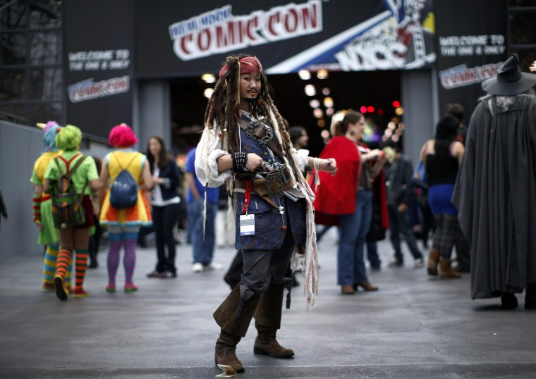 "A woman dressed as Captain Jack Sparrow from the ""Pirates of the Caribbean"" series poses for a photograph at New York's Comic-Con convention. (Mike Segar/Reuters)"