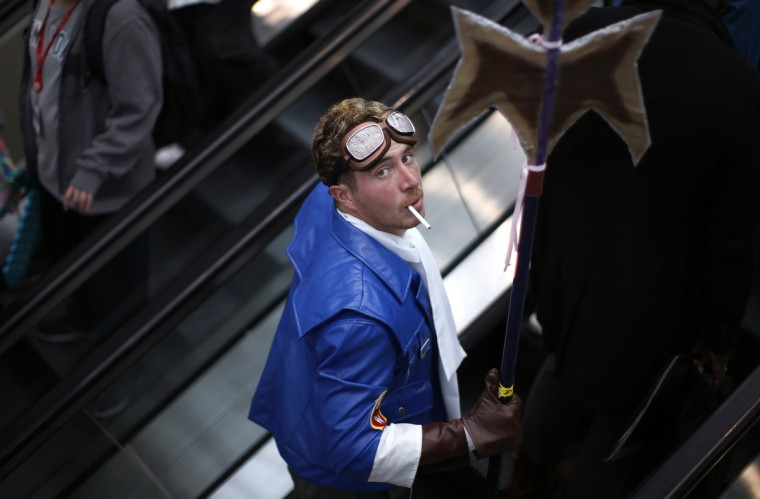 A fan in costume rides an escalator at New York's Comic-Con convention. (Mike Segar/Reuters)