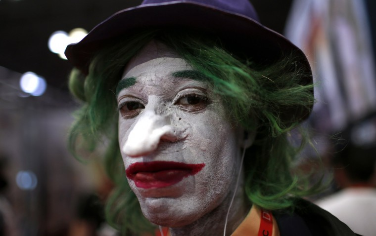A fan dressed as the Joker from the Batman comic and movie series poses for a photograph at New York's Comic-Con convention. (Mike Segar/Reuters)