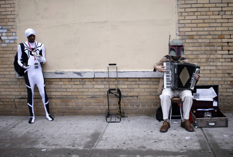 A costumed fan plays the accordion outside New York's Comic-Con convention. (Mike Segar/Reuters)