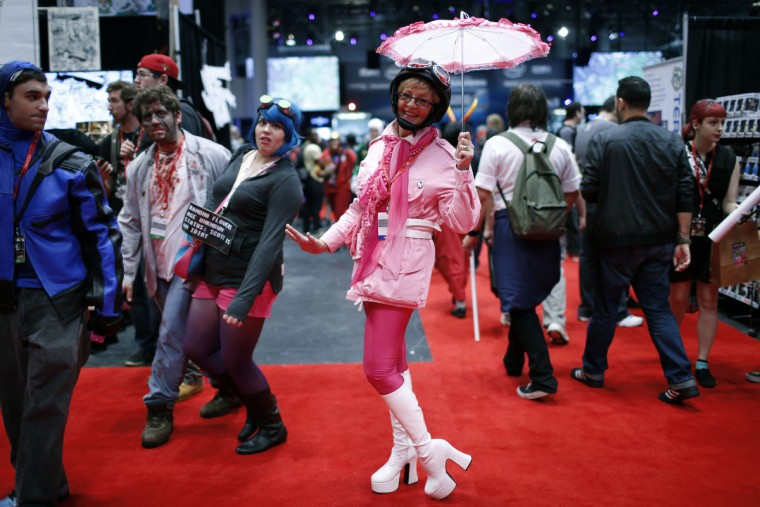 A woman dressed as Penelope Pitstop from the popular cartoon series poses for a photograph at New York's Comic-Con convention. (Mike Segar/Reuters)