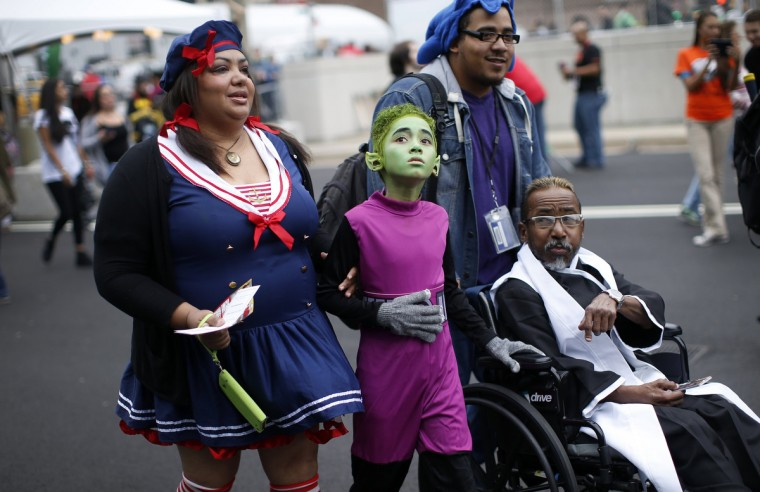 A family in costumes arrives at New York's Comic-Con convention. (Mike Segar/Reuters)