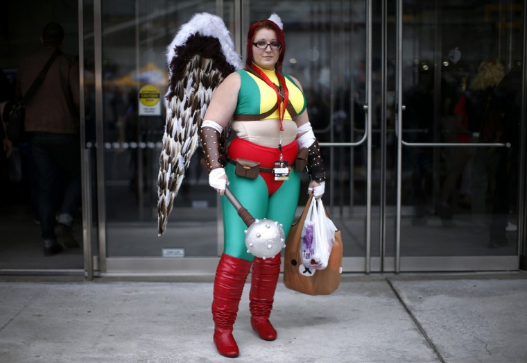 Stephanie Turner from Colorado dressed as Hawkgirl from the Justice League comic series poses for a photograph at New York's Comic-Con convention. (Mike Segar/Reuters)