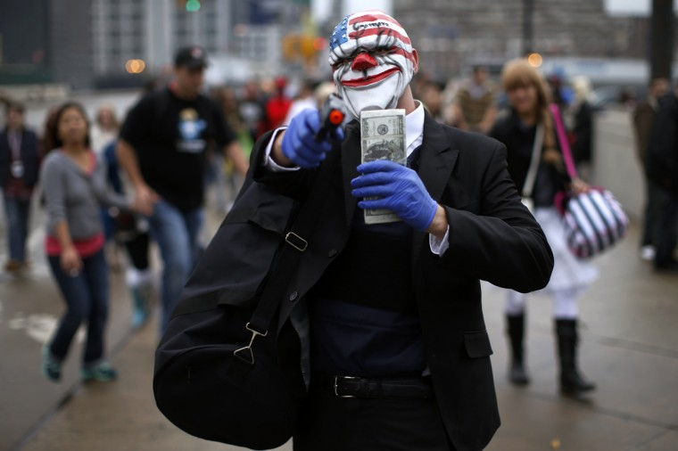 """A fan dressed as a character from the movie """"Heat"""" poses for a photograph at New York's Comic-Con convention. (Mike Segar/Reuters)"""