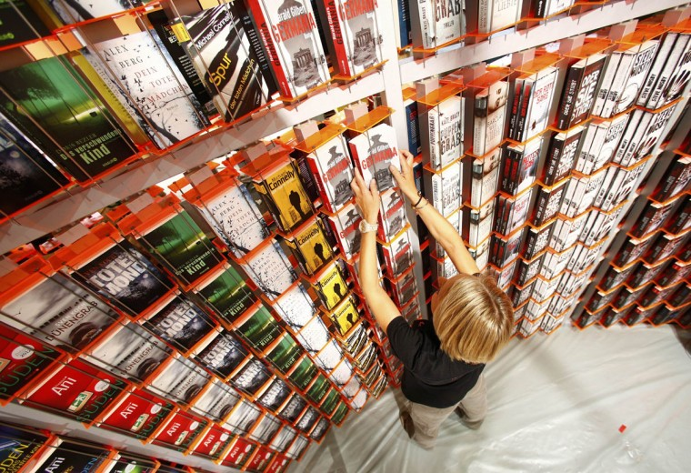 A woman sorts books at a booth during preparations for the upcoming book fair in Frankfurt, October 8, 2013. The world's largest book fair runs from October 9 to October 13 and features the literature of Brazil as its guest of honour. (Ralph Orlowski/Reuters)