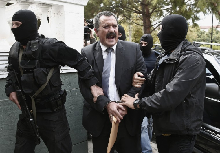 "Extreme-right Golden Dawn party senior lawmaker Christos Pappas is escorted by anti-terrorism police officers to a courthouse in Athens. The leader of the party was sent to jail pending trial on criminal charges on Thursday in a boost to a government campaign to wipe out what it calls ""a neo-Nazi criminal gang"". (Yorgos Karahalis/Reuters photo)"
