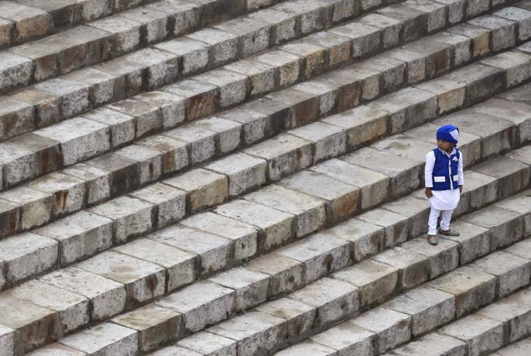 A Muslim boy stands on the stairs of the ruins of the Feroz Shah Kotla mosque during the Eid al-Adha festival in New Delhi. (Anindito Mukherjee/Reuters photo)