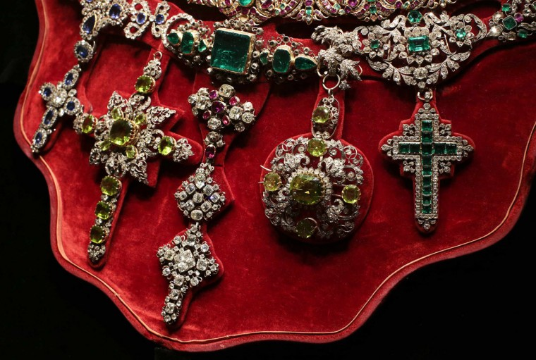 "The Necklace of San Gennaro, considered to be one of the most precious pieces of jewelry in the world, is seen on display during an exhibition in Rome October 29, 2013. One of the world's richest treasure troves went on display in Rome on Tuesday, including gem-studded chalices, sumptuous jewelry and golden trinkets collected over seven centuries. It was the first time such a large selection of the ""Treasure of San Gennaro"", precious objects donated in tributes to the patron saint of Naples, has been displayed outside of the southern Italian city. (Tony Gentile/Reuters)"