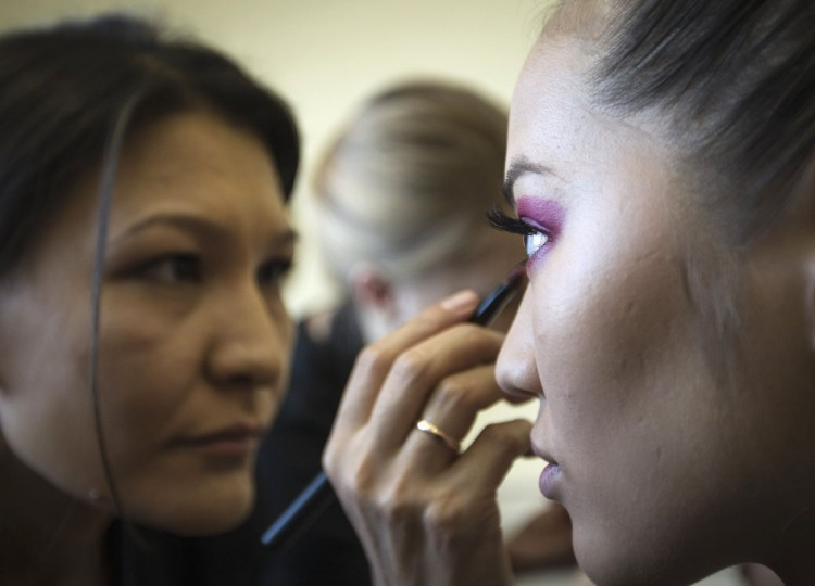 A model has her makeup done backstage during Kazakhstan Fashion Week in Almaty October 24, 2013. (Shamil Zhumatov/Reuters)