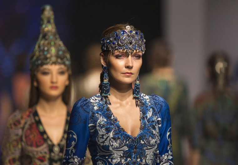 Models present creations by Kazakhstan's Aida Kaumenova design house during Kazakhstan Fashion Week in Almaty October 24, 2013. (Shamil Zhumatov/Reuters)