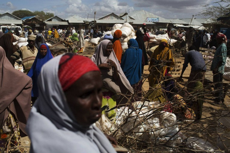 Somali refugees organise their collected ration of food during a distribution exercise outside a United Nations World Food Programme (WFP) center in Dagahale, one of the several refugee settlements in Dadaab, Garissa County, northeastern Kenya. (Siegfried Modola/Reuters)