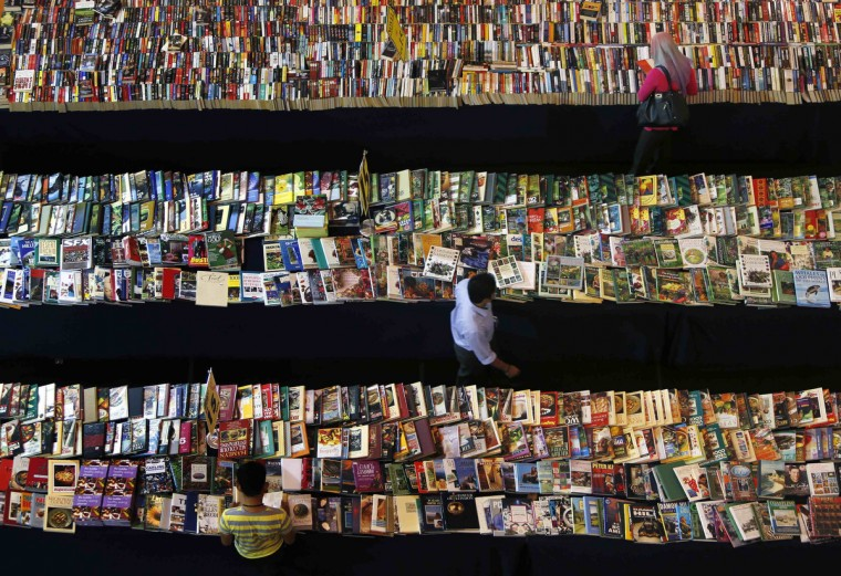 People browse books at a book stall in Petaling Jaya, outside Kuala Lumpur. (Samsul Said/Reuters photo)