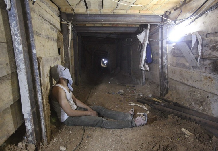 A tunnel worker rests inside a smuggling tunnel dug beneath the Gaza-Egypt border in the southern Gaza Strip. Hamas is struggling to meet its payroll in the Gaza Strip, where income from taxes has been badly hit since neighboring Egypt started destroying a network of tunnels used to smuggle food, fuel and weapons into the Islamist-run enclave. (Ahmed Zakot/Reuters)