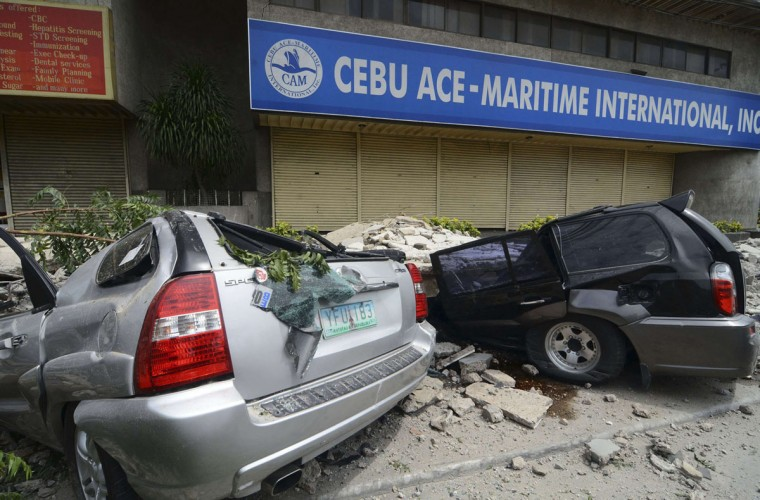 A view of vehicles that were damaged by falling debris after an earthquake struck Cebu city, central Philippines. (Reuters photo)