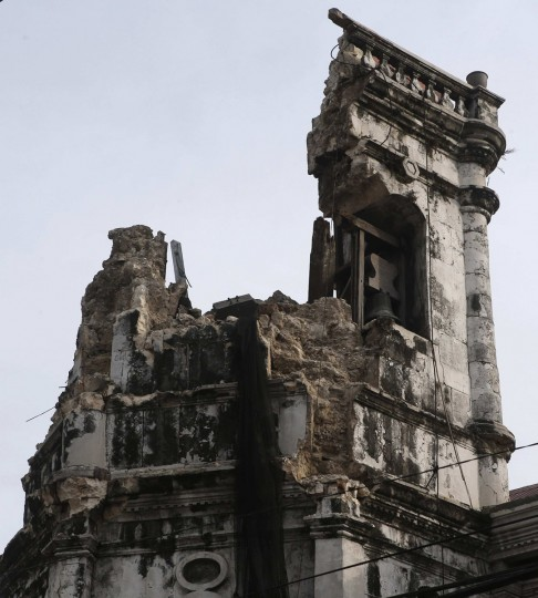 A view shows the damaged bell tower of centuries-old Basilica Minore of Sto Nino de Cebu church after an earthquake struck Cebu city, in central Philippines. (Erik De Castro / Reuters)