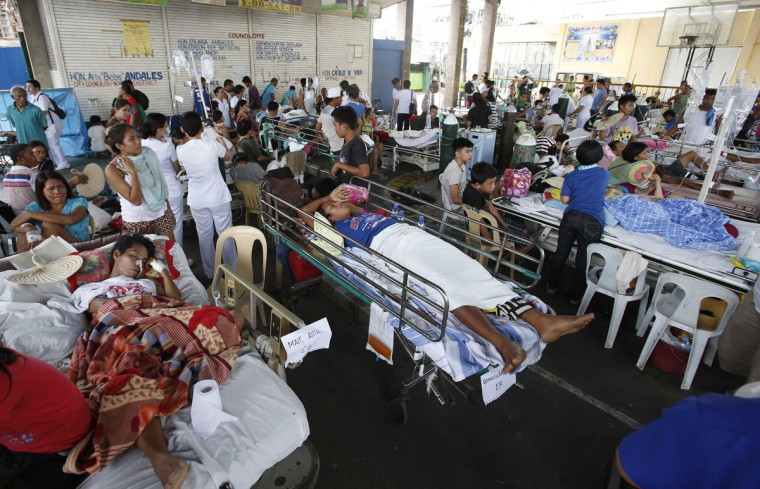 Hospital patients rest after they were evacuated to a covered court after an earthquake struck Cebu city, in central Philippines. (Erik De Castro / Reuters)