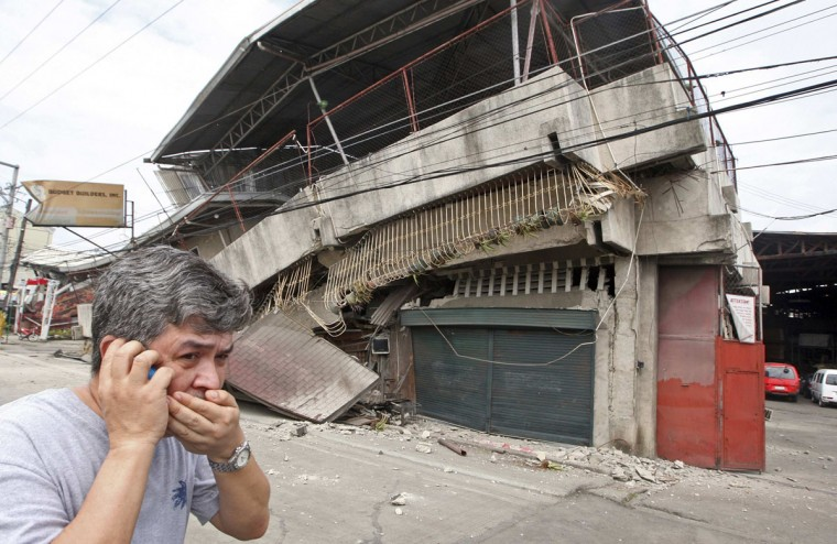 A resident walks past a building collapsed during an earthquake in Cebu city, central Philippines. (Reuters photo)