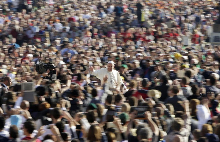 Pope Francis waves as he arrives to lead his Wednesday general audience in Saint Peter's square at the Vatican. (Max Rossi/Reuters)
