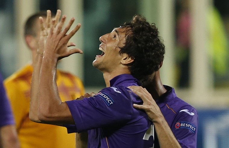 Fiorentina's Ryder Matos (L) celebrates after scoring against Pandurii Targu-Jiu during their Europa League soccer match at the Artemio Franchi stadium in Florence October 24, 2013. (Alessandro Bianchi/Reuters)