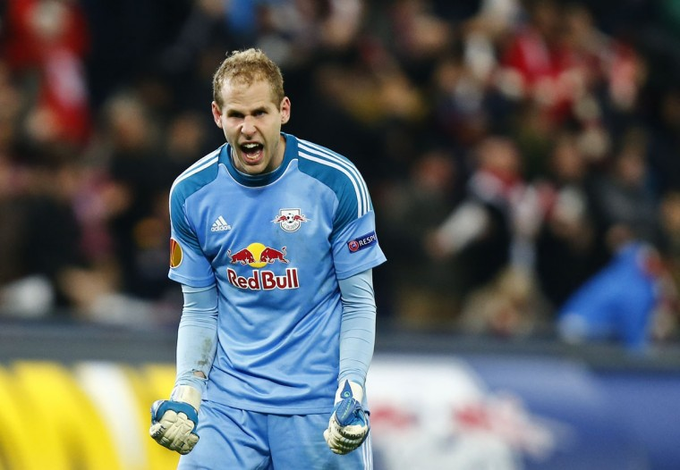 Salzburg's Peter Gulacsi reacts after his team scored a goal during their Europa League Group C soccer match in Salzburg October 24, 2013. (Dominic Ebenbichler/Reuters)