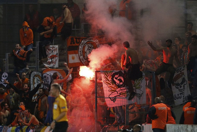 Apoel Nicosia's supporters celebrate after Esmael Goncalves scored against Girondins' Bordeaux during their Europa League soccer match at the Chaban-Delmas stadium in Bordeaux October 24, 2013. (Regis Duvignau/Reuters)
