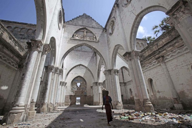 A boy stands inside a destroyed church in the Hamerweyne district of Mogadishu September 26, 2013. Street lamps now brighten some of Mogadishu's battle-scarred roads and couples hold hands at the seaside next to bombed-out beachfront buildings, a scene that would have been unthinkable when the Islamist al Shabaab group held sway here. However, rebuilding a life many in the world take for granted is a slow process after more than 20 years of civil war and anarchy in Somalia. Islamists, who control swathes of countryside and some towns, have launched several attacks in Mogadishu, and last month they showed their reach, claiming responsibility for a deadly attack on a Kenyan shopping mall. (Feisal Omar/Reuters)