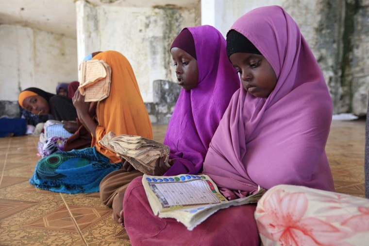 Children read during a Koranic studies lesson inside a classroom in the Hodan area of Mogadishu September 25, 2013. Street lamps now brighten some of Mogadishu's battle-scarred roads and couples hold hands at the seaside next to bombed-out beachfront buildings, a scene that would have been unthinkable when the Islamist al Shabaab group held sway here. However, rebuilding a life many in the world take for granted is a slow process after more than 20 years of civil war and anarchy in Somalia. Islamists, who control swathes of countryside and some towns, have launched several attacks in Mogadishu, and last month they showed their reach, claiming responsibility for a deadly attack on a Kenyan shopping mall. (Feisal Omar/Reuters)