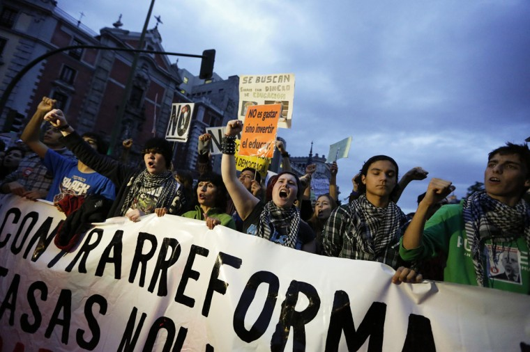 Protesters take part in a demonstration on the third day of a nationwide student strike against rising fees and educational cuts in Madrid October 24, 2013. (Juan Medina/Reuters)