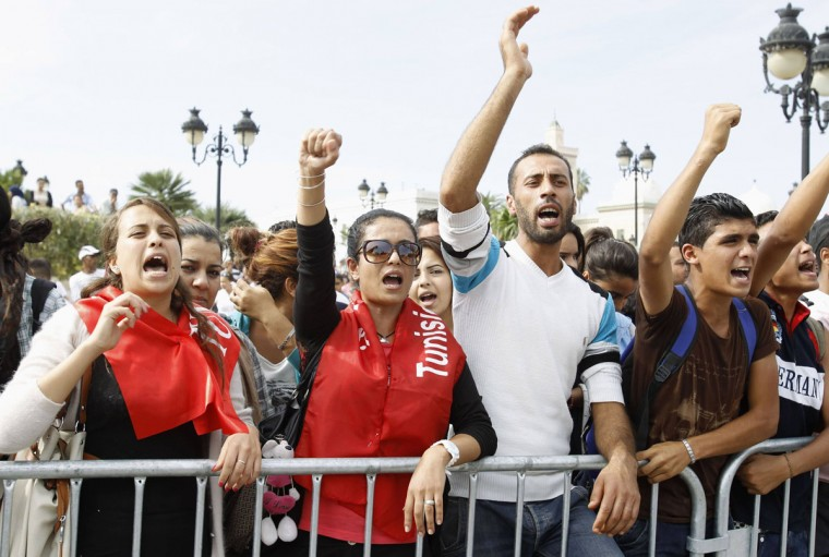 Anti-government protesters shout slogans during a demonstration in Tunis October 24, 2013. Seven Tunisian policemen were killed in clashes with militants on Wednesday as the government cracked down on Islamist fighters using the chaos in neighboring Libya to get weapons and training. The violence, some of the worst since Tunisia's 2011 uprising, unsettled the start of negotiations between the Islamist-led government and opposition to end a crisis over the country's transition to democracy. (Zoubeir Souissi/Reuters)