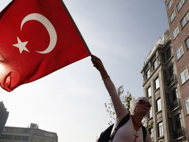 A woman waves the national flag and shouts anti-government slogan in central Istanbul October 29, 2013. People gathered to mark the 90th anniversary of the Republic Day. (Osman Orsal/Reuters)